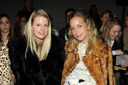 Karen Duffy and Meredith Melling Burke attend the Giulietta fall 2013 fashion show during Mercedes-Benz Fashion Week at Cafe Rouge on February 13, 2013 in New York City.