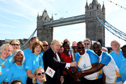 (EDITORIAL USE ONLY, NO SALES)  In this handout image provided by Glasgow 2014 Ltd, (L-R) Mayor of London Boris Johnson, Olympic gold medalist Christine Ohurugu, Michael Pusey and Faramolu Johnson pose with Queen's Baton as it arrives in London on June 06, 2014 in London, England. England is nation 69 of 70 nations and territories the Queen's Baton will visit.