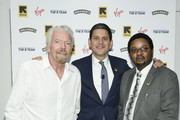 (L-R) Virgin Founder Sir Richard Branson, International Rescue Committee CEO David Miliband and Nigerian asylee turned businessman Obayemi Olawale pose at the Business Refugee Action Network event in the margins of the United Nations General Assembly on September 24, 2019 in New York City. At the event, more than a dozen CEOs signed up to support refugees and to call on governments to include them in progress towards the Sustainable Development Goals.