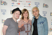 (L-R) Musician Patrick Stump, President of Earth Day Network Kathleen Rogers and musician Peter Wentz pose backstage during Global Citizen 2015 Earth Day on National Mall to end extreme poverty and solve climate change on April 18, 2015 in Washington, DC.