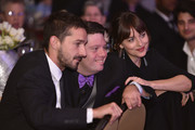 Shia LaBeouf, Zack Gottsagen with Dakota Johnson at the Global Down Syndrome 10th anniversary BBBY fashion show at Sheraton Denver Downtown Hotel on October 20, 2018 in Denver, Colorado.
