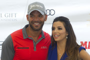 Eva Longoria (R) and Amaury Nolasco (L) attend the Global Gift Celebrity Golf Tournament to help raise money for The Eva Longoria Foundation and The Bertin Osborne Foundation at La Quinta Golf & Country Club on July 19, 2014 in Marbella, Spain.