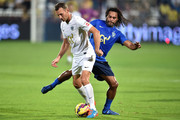 Andriy Shevchenko (L) of Team Figo runs with the ball against Christian Karembeu (R) of Team Cannavaro during the Global Legends Series match, at the SCG Stadium on December 5, 2014 in Bangkok, Thailand.