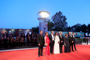 "(L-R) Robinson Stevenin, Lola Naymark, Jean-Pierre Darroussin, Anais Demoustier, Robert Guediguian, Ariane Ascaride, Gerard Meylan  and Gregoire Leprince-Ringuet walk the red carpet ahead of the ""Gloria Mundi"" screening during the 76th Venice Film Festival at Sala Grande on September 05, 2019 in Venice, Italy."