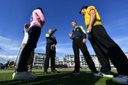 Umpires, Michael Gough and Neil Mallender talk to the two captains prior to the Vitality Blast match between Gloucestershire and Middlesex at The Brightside Ground on August 9, 2018 in Bristol, England.
