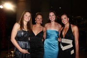 (L-R) Swimmers Elizabeth Pelton, Elizabeth Beisel, Christine Magnuson, and Rebecca Soni pose for a photo during the 2009 USA Swimming Foundation Golden Goggles Awards on November 22, 2009 at the Beverly Hills Hilton in Beverly Hills, California.