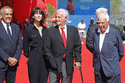 (L-R) Alberto Barbera, Sophie Marceau, Jean Paul Belmondo and guests attend the Golden Lion For Jean Paul Belmondo followed by the 'Le Voleur' Premiere during the 73rd Venice Film Festival at Sala Grande on September 8, 2016 in Venice, Italy.
