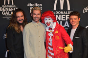 """Tom Kaulitz (l-r), musician, Bill Kaulitz, singer, Ronald McDonald and Georg Listing, musician, attend the """"Golden Society - Family & Friends"""" Charity Gala by McDonald's at Hotel Bayerischer Hof on November 09, 2019 in Munich, Germany."""