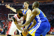 James Harden #13 of the Houston Rockets drives against Festus Ezeli #31 and Klay Thompson #11 of the Golden State Warriors in the first quarter during Game Three of the Western Conference Finals of the 2015 NBA PLayoffs at Toyota Center on May 23, 2015 in Houston, Texas. NOTE TO USER: User expressly acknowledges and agrees that, by downloading and or using this photograph, user is consenting to the terms and conditions of Getty Images License Agreement.