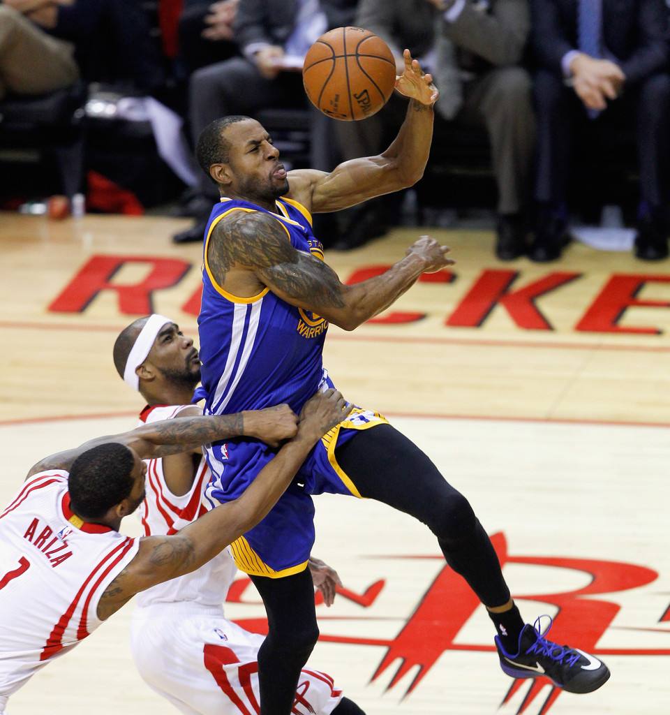 Rockets And The Warriors Game: Corey Brewer And Andre Iguodala Photos Photos