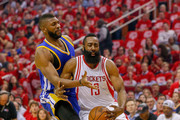 James Harden #13 of the Houston Rockets is fouled by Festus Ezeli #31 of the Golden State Warriors as he drives to the basket  at Toyota Center on April 21, 2016 in Houston, Texas.  NOTE TO USER: User expressly acknowledges and agrees that, by dowloading and/or using this photograph, user is consenting to the terms and conditions of the Getty Images License Agreement.