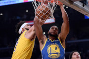 Andre Iguodala #9 of the Golden State Warriors dunks between JaVale McGee #7 and Josh Hart #3 of the Los Angeles Lakers during a 130-111 Golden State Warriors win at Staples Center on January 21, 2019 in Los Angeles, California.  NOTE TO USER: User expressly acknowledges and agrees that, by downloading and or using this photograph, User is consenting to the terms and conditions of the Getty Images License Agreement.