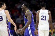 Draymond Green #23 of the Golden State Warriors argues a call in front of Dario Saric #9 and Joel Embiid #21 of the Philadelphia 76ers in the second half at Wells Fargo Center on November 18, 2017 in Philadelphia,Pennsylvania. NOTE TO USER: User expressly acknowledges and agrees that, by downloading and or using this photograph, User is consenting to the terms and conditions of the Getty Images License Agreement.