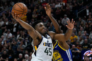 Donovan Mitchell #45 of the Utah Jazz goes for the basket against Kevin Durant #35 of the Golden State Warriors in the second half of a NBA game at Vivint Smart Home Arena on October 19, 2018 in Salt Lake City, Utah. NOTE TO USER: User expressly acknowledges and agrees that, by downloading and or using this photograph, User is consenting to the terms and conditions of the Getty Images License Agreement.