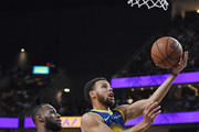 Stephen Curry #30 of the Golden State Warriors drives to the basket ahead of LeBron James #23 of the Los Angeles Lakers during their preseason game at T-Mobile Arena on October 10, 2018 in Las Vegas, Nevada. The Lakers defeated the Warriors 123-113. NOTE TO USER: User expressly acknowledges and agrees that, by downloading and or using this photograph, User is consenting to the terms and conditions of the Getty Images License Agreement.