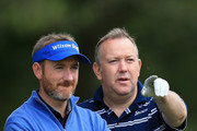 Alan Reid of West Lothiam GC and partner Graham Fox of Clydeway Golf(L) chat during day two of the Golfbreaks.com PGA Fourball Championship Final at De Vere Carden Park Hotel on August 13, 2015 in Chester, England.