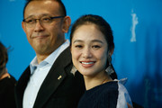 Director Jiang Wen and actress Zhou Yun attend the 'Gone with the Bullets' (Yi bu zhi yao) photocall during the 65th Berlinale International Film Festival at Grand Hyatt Hotel on February 11, 2015 in Berlin, Germany.