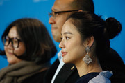 Actress Hung Huang, director Jiang Wen and actress Zhou Yun attend the 'Gone with the Bullets' (Yi bu zhi yao) photocall during the 65th Berlinale International Film Festival at Grand Hyatt Hotel on February 11, 2015 in Berlin, Germany.