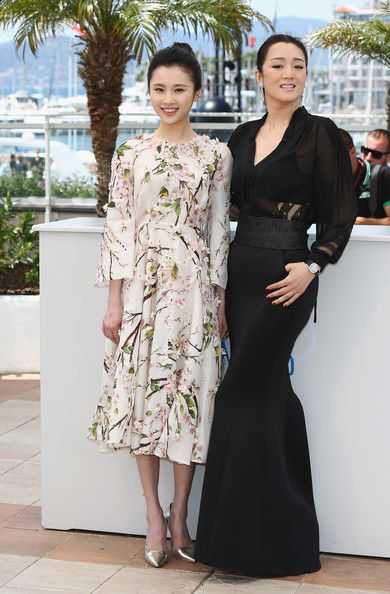 'Coming Home' Photo Call at Cannes [coming home photocall,coming home,clothing,fashion,dress,lady,haute couture,leg,fashion design,formal wear,fashion model,event,huiwen zhang,gong li,photocall,cannes,france,cannes film festival]