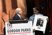 Honoree, Businessman and philanthropist Ronald O. Perelman and Film Director, Presenter Spike Lee present art on stage at Gordon Parks Foundation: 2018 Awards Dinner & Auction at Cipriani 42nd Street on May 22, 2018 in New York City.