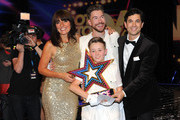 """Davina McCall and Adam Garcia pose with 'Duplic8', who were announced as overall winners during the live final of 2014's """"Got To Dance"""" at Earls Court on August 29, 2014 in London, England."""