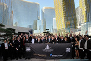 Dignitaries including MGM Mirage board members Willie Davis and Mel Wolzinger, MGM Mirage CFO Dan D'Arrigo, MGM Mirage Chairman and CEO Jim Murren and President and COO of Infinity World Development Bill Grounds ring the bell to close the trading day on the New York Stock Exchange during the grand opening for the Aria Resort & Casino at CityCenter December 16, 2009 in Las Vegas, Nevada. The 67-acre, USD 8.5 billion mixed-use urban development center, a joint project between MGM Mirage and Dubai World, is said to be the biggest privately financed construction project in United States history and one of the world's largest green projects being built with the Leadership in Energy & Environmental Design (LEED) Gold certified Green Building Rating System. Aria is CityCenter's centerpiece and includes a 150,000-square-foot casino and 4,004 hotel rooms and suites.