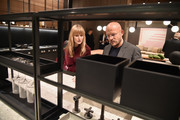 Architectural Digest Editor in Chief Amy Astley and architect Vincent Van Duysen inspect a kitchen design at the Grand Opening Dinner Celebration of Molteni Group's New York Flagship on May 16, 2018 in New York City.