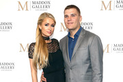 Paris Hilton and Chris Zylka attend the Grand Opening Maddox Gallery Los Angeles on October 11, 2018 in West Hollywood, California.