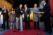 (L-R) Mandarin Oriental Hotel Group Chief Executive Edouard Ettedgui, recording artist Vanessa-Mae, U.S. Rep. Dean Heller (R-NV), MGM Mirage Chairman and CEO Jim Murren, CityCenter President and CEO Bobby Baldwin and President and COO of Infinity World Development Bill Grounds celebrate after cutting a ribbon during the grand opening of the resort December 4, 2009 in Las Vegas, Nevada. The 47-story nongaming luxury hotel and condominium tower is the third part of the 67-acre, USD 8.5 billion mixed-use urban development center to open. The joint project between MGM Mirage and Dubai World is said to be the biggest privately financed construction project in United States history and one of the world's largest green projects being built with the Leadership in Energy & Environmental Design (LEED) Gold certified Green Building Rating System.