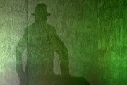 The shadow of George Galloway projects on a wall as he speaks during the Grassroots Out rally at the Queen Elizabeth II Conference Centre on February 19, 2016 in London, England. Grassroots Out (also known as GO) is a cross party union made of politicians and political supporters from across the political spectrum campaigning for the United Kingdom to leave the European Union.