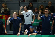 Andy Murray and Kyle Edmund of Great Britain celebrate as they watch the semi-final doubles match between Jamie Murray and Neal Skupski of Great Britain and Rafael Nadal and Feliciano Lopez of Spain during Day Six of the 2019 Davis Cup at La Caja Magica on November 23, 2019 in Madrid, Spain.