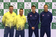 Sam Groth and Lleyton Hewitt of Australia (L) pose for a photo with Jamie Murray and Dom Inglot of Great Britain (R) at Emirates Arena on September 17, 2015 in Glasgow, Scotland.