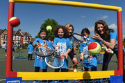 TV Presenter Gabby Logan and Former British No. 1 Tennis player Annabel Croft pose for pictures with kids from Heathbrook Primary School as they launch the Great British Tennis Weekend at Clapham Common on May 13, 2015 in London, England.