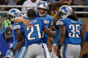 Reggie Bush #21celebrates with Matthew Stafford #9 of the Detroit Lions after scoring a third quarter touchdown against the Green Bay Packers at Ford Field on September 21, 2014 in Detroit, Michigan.