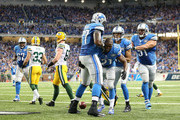Reggie Bush #21 of the Detroit Lions celebrates with teammates Cornelius Lucas #77 and Dominic Raiola #51 after scoring on a 21 yard touchdown during the fourth quarter of the game against the Bay Packers at Ford Field on September 21, 2014 in Detroit, Michigan. The Lions defeated the Packers 19-7.