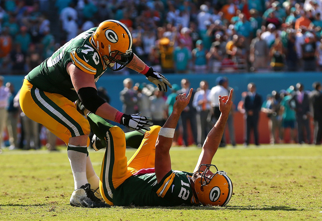 Aaron Rodgers And TJ Lang Photos
