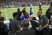 Adrian Peterson #28 of the Minnesota Vikings has his knee tended to on the sidelines in the third quarter of their game against the Green Bay Packers on September 18, 2016 at US Bank Stadium in Minneapolis, Minnesota.