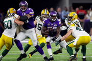 Running back Adrian Peterson #28 of the Minnesota Vikings carries the ball during the game against the Green Bay Packers on September 18, 2016 in Minneapolis, Minnesota.