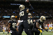 Jimmy Graham #80 of the New Orleans Saints celebrates with teammates after a touchdown in the second quarter against the Green Bay Packers at Mercedes-Benz Superdome on October 26, 2014 in New Orleans, Louisiana.