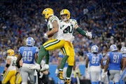 Lance Kendricks #84 of the Green Bay Packers celebrates his touchdown with teammate Jimmy Graham #80 against the Detroit Lions during the second half at Ford Field on October 7, 2018 in Detroit, Michigan.