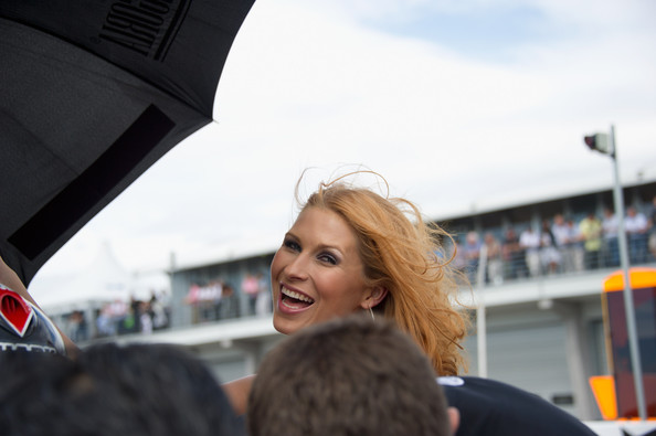Grid girl grid girls smiles on grid during the motogp of germany at