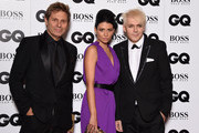 (R-L) Nick Rhodes, Nefer Suvio and Roger Taylorattends the GQ Men Of The Year Awards at The Royal Opera House on September 8, 2015 in London, England.