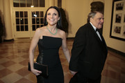 Actress Julia Louis-Dreyfus, left, and William Louis-Dreyfus arrive to a state dinner hosted by U.S. President Barack Obama and U.S. first lady Michelle Obama in honor of French President Francois Hollande at the White House on February 11, 2014 in Washington, DC. Obama and Hollande said the U.S. and France are embarking on a new, elevated level of cooperation as they confront global security threats in Syria and Iran, deal with climate change and expand economic cooperation.