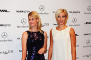 Natascha Gruen (L) and Verena Kerth attend the Guido Maria Kretschmer Show during the Mercedes Benz Fashion Week Spring/Summer 2011 at Hotel de Rome on July 7, 2010 in Berlin, Germany.