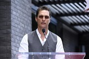 Actor Matthew McConaughey speaks on stage at the star ceremony for Chef Guy Fieri who was honored with the 2,664th Star on the Hollywood Walk of Fame Star, in Hollywood, California.