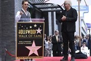 Guest speaker Matthew McConaughey  (L) with Chef Guy Fieri (R) who was honored with the 2,664th Star on the Hollywood Walk of Fame Star, in Hollywood, California.
