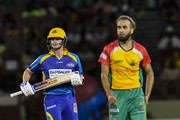 In this handout image provided by CPL T20, Steve Smith (L) of Barbados Tridents gets runs off Imran Tahir (R) of Guyana Amazon Warriors during match 6 of the Hero Caribbean Premier League match between Guyana Amazon Warriors and Barbados Tridents at Guyana National Stadium on August 12, 2018 in Providence, Guyana.