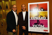 """Author David L Marcus (L) and director  John Waters attend reception for HBO Documentary Film """"Bully. Coward. Victim. The Story Of Roy Cohn"""" World Premiere at The New York Film Festival at Bar Boulud on September 29, 2019 in New York City."""