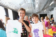"In this photo provided by Nintendo of America, Jacob Hopkins from ""The Amazing World of Gumball"" and Benjamin Stockham from ""About a Boy"" attend the Kirby: Planet Robobot event celebrating the games launch at Smashbox Studios in Culver City, California, on June 22, 2016. In this new action-packed adventure, Kirby gets new abilities and transformations, such as flamethrower arms and buzz-saw hands."