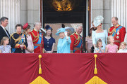 Vice Admiral Sir Tim Laurence, Princess Anne, Princess Royal, Princess Beatrice, Lady Louise Windsor,  Prince Andrew, Duke of York, Queen Elizabeth II, Meghan, Duchess of Sussex, Prince Charles, Prince of Wales, Prince Harry, Duke of Sussex, Catherine, Duchess of Cambridge, Prince William, Duke of Cambridge, Princess Charlotte of Cambridge, Savannah Phillips, Prince George of Cambridge and Isla Phillips watch the flypast on the balcony of Buckingham Palace during Trooping The Colour on June 9, 2018 in London, England. The annual ceremony involving over 1400 guardsmen and cavalry, is believed to have first been performed during the reign of King Charles II. The parade marks the official birthday of the Sovereign, even though the Queen's actual birthday is on April 21st.